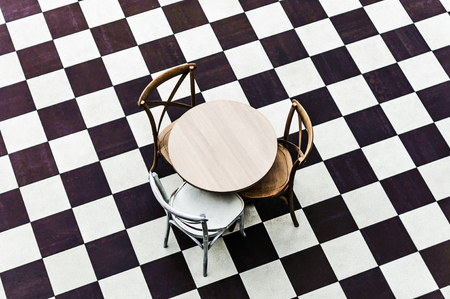 dining table and chairs: modern chair for interior design and a table on a chessboard floor