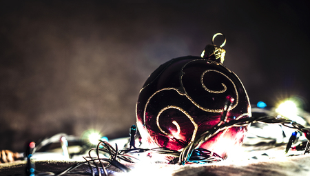 Christmas decorative toy, glowing with a garland Stock Photo