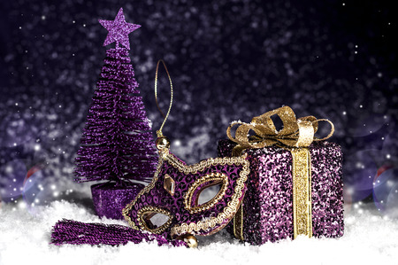 bright christmas decorative toys on a purple background in the snow Stock Photo