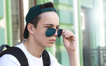 serious young man on a city street on a sunny day Stockfoto