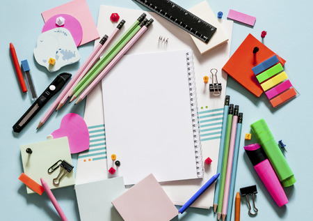 beautiful office supplies for school and office on a blue background Archivio Fotografico