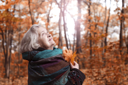 Portrait an elderly woman in autumn afternoon Stock Photo