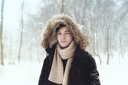 serious young man in the park in winter