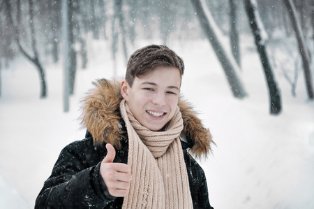 happy young man in the park in winter