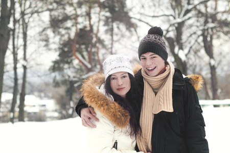 happy young people on a walk in winter park Stock Photo