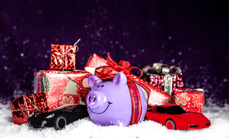 Purple pig with a red bow, miniature cars in the snow, presents