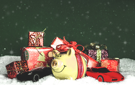 Yellow pig with a red bow, miniature cars in the snow, presents