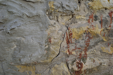 foundation cracks: stone old wall in plaster and cracks