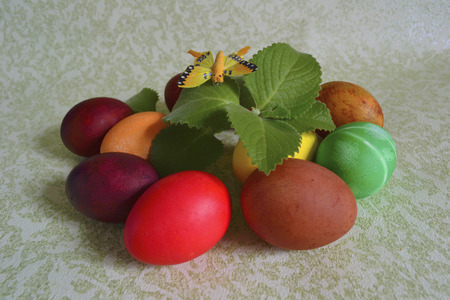 colored dye: Easter colored food dye chicken eggs with mint sprig and butterfly