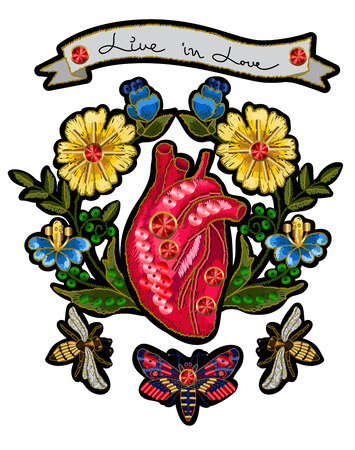 Embroidery in the form of heart with flowers and insects.