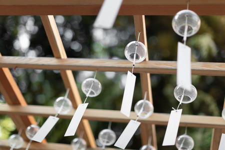 Many glass wind chimes. Japanese wind bells fuurin festival matsuri. Summer trip to Japan concept.