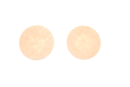 Nude nipple covers isolated on white background. Flat-lay, top view. Copy space for your text. 스톡 콘텐츠