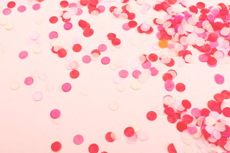 Valentine day, Birthday or party background. Confetti on pink background. Flatlay, top view.