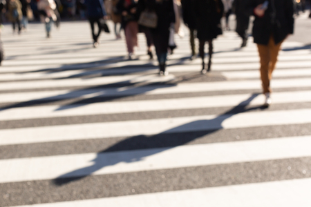 Blurred people on busy crosswalk. Tokyo and Japan background concept.