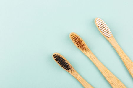 Three bamboo tooth brushes on light green background. Zero waste and plastic free concept. Copy space for your text. Stock fotó