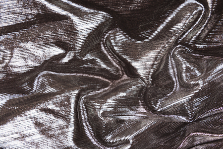 Metallic grey fabric background. Flat lay, top view. Copy space for your text. Stock fotó