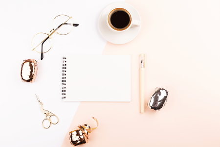 Creative feminine workspace background. Notepad, glasses, coffee. Flat-lay, top view. Copy space.