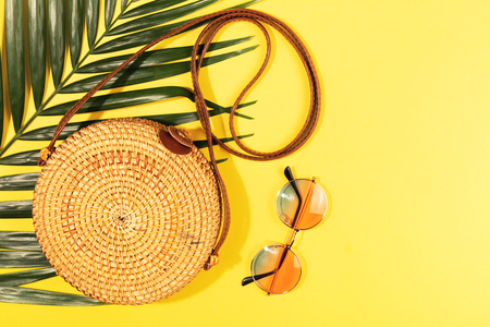Minimal composition of a bamboo bag on yellow background. Flat lay, top view. Copy space.