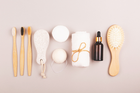 Plastic free personal care products on grey background. Zero waste  shopping for home. Eco friendly choice of living.