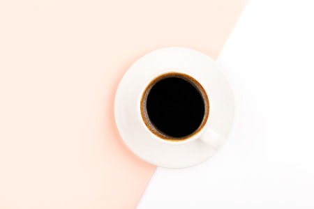 A cup of coffee on beige and wtite color combination background. Flat lay, top view. Copy space for your text. Stock fotó