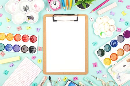 Back to school concept. Variety of stationery or art items with a clipboard. Flat-lay, top view. Stock fotó