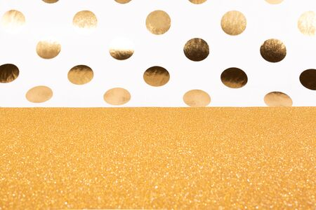 Abstract gold glitter and dots combination background. Christmas, New Year, holiday or party background.
