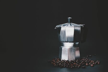 Dark and moody shot of a coffee maker and coffee beans. Copy space for your text. Stock fotó