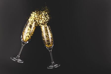 Creative shot of two champagne glasses and confetti. Christmas, New Year, party concept. Flat lay, top view. Moody toning. Stock fotó