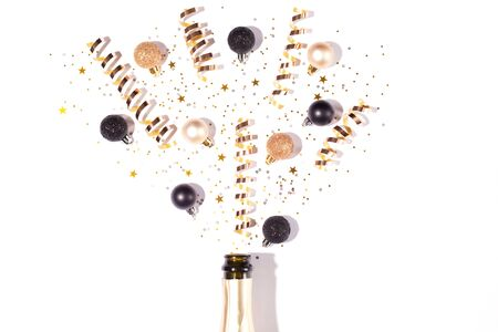 Creative Christmas or New Year composition with champagne bottle and confetti. Flat lay, top view. Copy space. Stock fotó