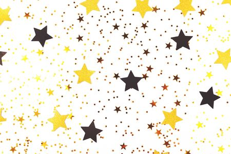 Falling star shape confetti and sparkles on white background. Flat lay, top view, copy space for your text.