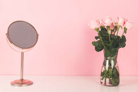 Mirror and beautiful roses. Vanity table concept.