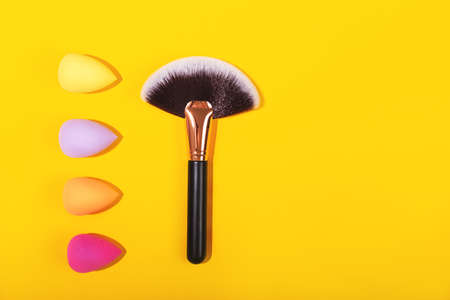 Colorful beauty sponges on bright yellow background. Stok Fotoğraf
