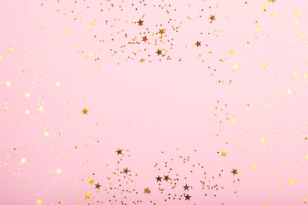 A bodrer made with falling confetti on pink background.