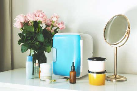 Mini fridge on the vanity table. Selfcare concept.