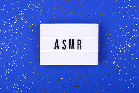 The lamp with letters ASMR on blue background. Stok Fotoğraf
