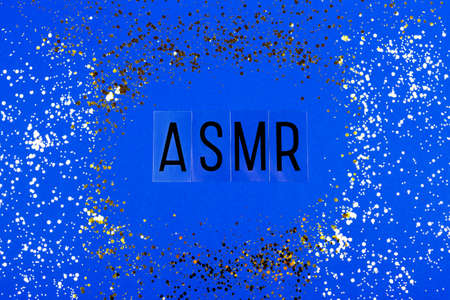 Letters ASMR on the blue background. Flat-lay.