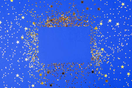 A bodrer made with falling confetti on blue background.