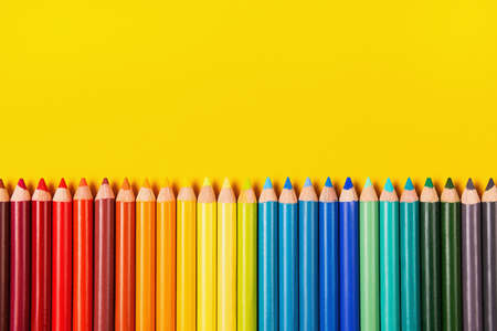 Beautiful color pencils on the yellow background. 版權商用圖片