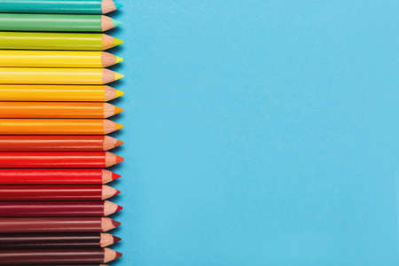 Beautiful color pencils on the blue background. 版權商用圖片