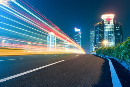 The urban landscape at night and through the city traffic photo