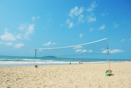 Beach volleyball court as well as the background of the sea photo