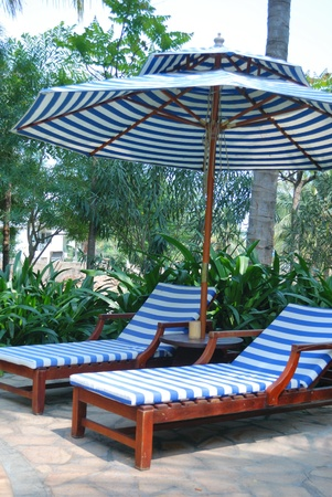 Chair next to the courtyard pool photo