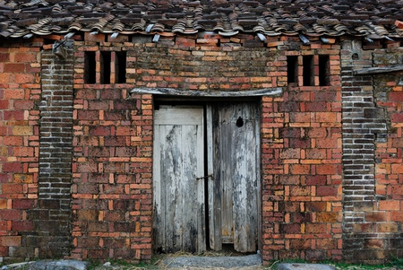 windows and doors: Severe corrosion of the mud-brick hut weathered facades,