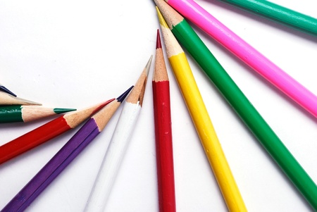 Color pencils in arrange in color wheel colors on white background photo