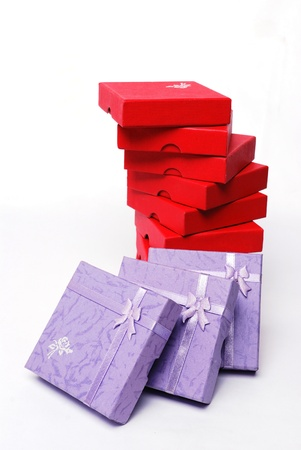 Stack of multicolored gifts on white background. photo