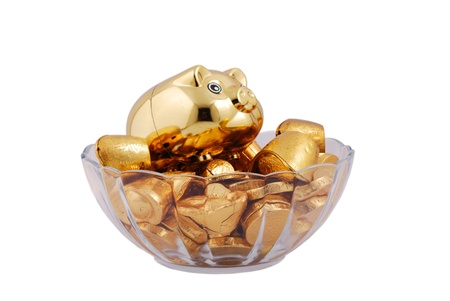Gold pigs, ingots, coins isolated on a white background photo