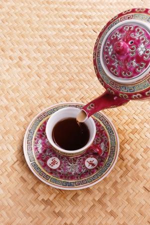 electroplating: Ceramic tea isolated on bamboo background Stock Photo