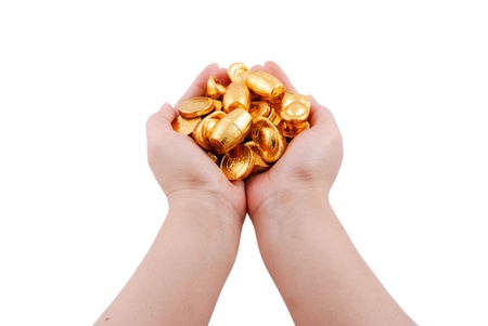 Closeup of hands holding gold coins photo