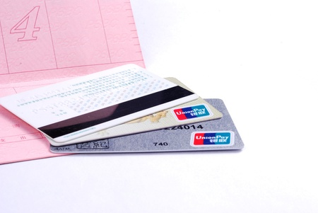 cardkey: Bank card and passbook isolated on a white background