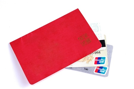 Bank card and passbook isolated on a white background